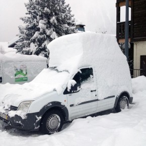 What is it about a car covered in snow that's so appealing?